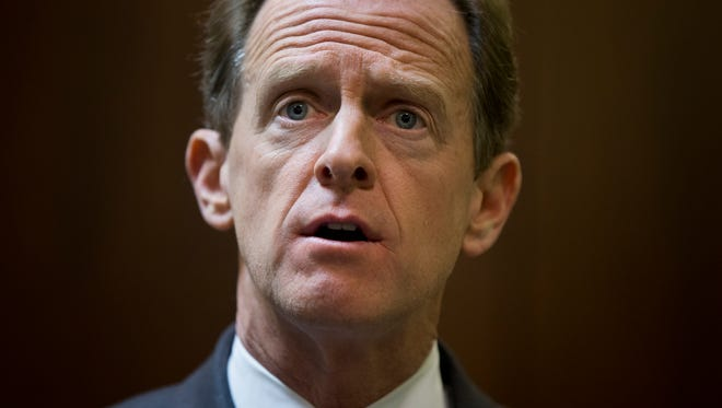 Sen. Pat Toomey, R-Pa., speaks with members of the media during a news conference, Monday, May 9 in Philadelphia.