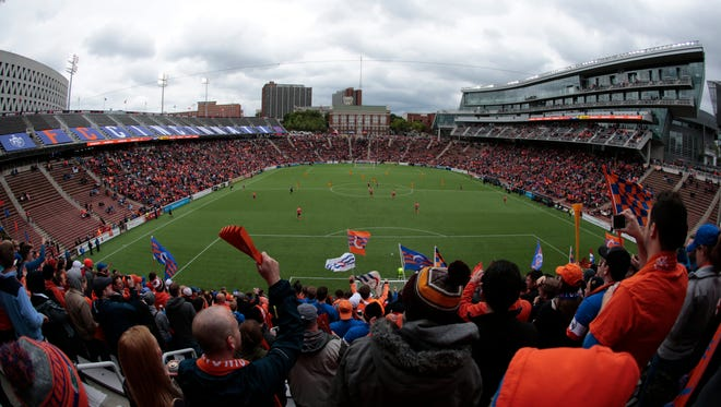 FC Cincinnati fans in The Bailey section cheer on the team before the start of the USL soccer game between the Pittsburgh Riverhounds and FC Cincinnati, Saturday, May 14, 2016, at Nippert Stadium in Cincinnati.