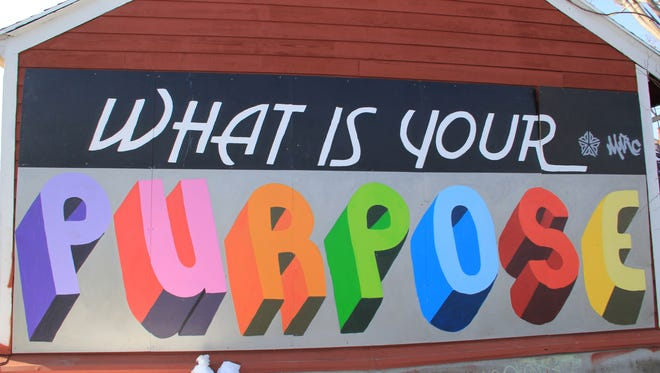 Shawn Dunwoody's 'What Is Your Purpose?' mural on East Main Street in Rochester.