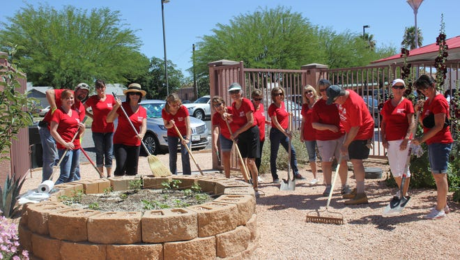 All 17 Keller Williams Realty employees volunteered their Thursday to help out the Virgin Valley Heritage Museum.