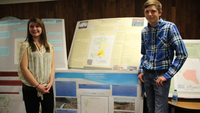 Holly Roper (left) and Kody Oliver (right) show their project.
