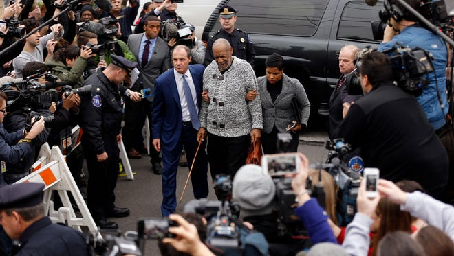 Bill Cosby, center, accompanied by his attorneys Brian McMonagle, left, and Monique Pressley, arrives at court to face a felony charge of aggravated indecent assault in Elkins Park, Pennsylvania in December 2015.
