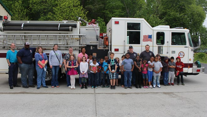 Courtney William's second grade class at Pungoteague Elementary School enjoyed a tour and fire truck ride at the Melfa Volunteer Fire Station recently after raising the most money for the station at school.