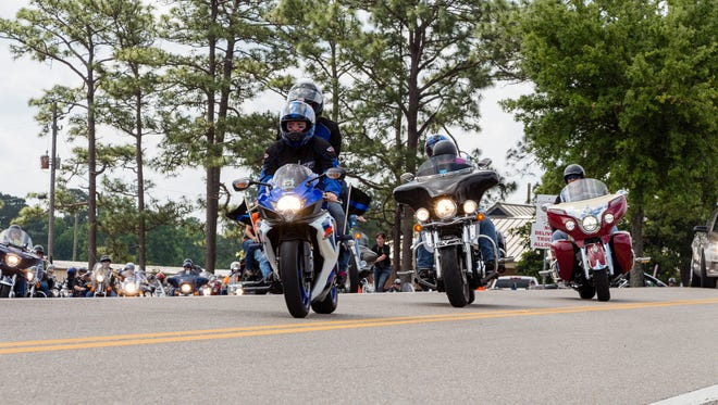 Riders depart Hattiesburg Cycles for the second annual Deen & Tate End of Watch Memorial Motorcycle Ride on Saturday.