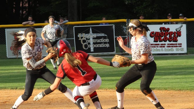 Clarksville High shortstop Sarah McClellan (left) steps on second base as teammate McKinleigh Guthrie looks on while Ravenwood's Sydney Hughes (1) tries to slide into the base during the 3A softball sectional Saturday at CHS.