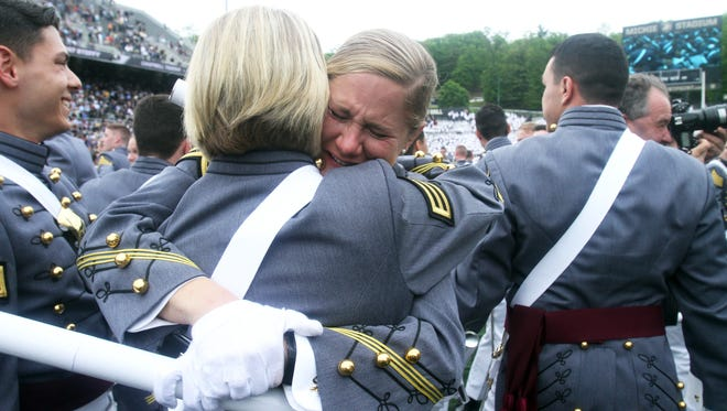 Graduates Allison McDonald of Wentzville, MO, cries as she celebrates with Jordan Bray of Tampa, Fla. at the conclusion of  the the United States Military Academy Graduation and Commissioning Ceremony at West Point May 21, 2016.