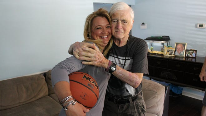 Former professional basketball player Tiffany Woosley hugs Alive Hospice patient Harvey Branch, who followed her when she played for the Lady Vols as well as the Shelbyville Central High School Eaglettes.