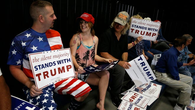 Supporters of Republican presidential candidate Donald Trump wait for Trump to arrive at a campaign event, in Albuquerque, N.M., Tuesday, May 24, 2016. (AP Photo/Brennan Linsley)
