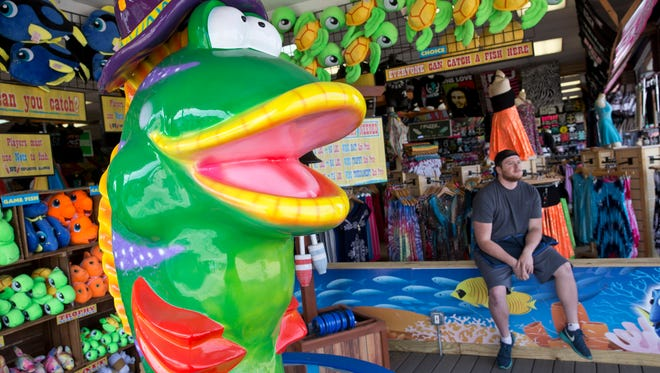 Corey Foltzer waits for customers at Bob's Fishin Hole stand in Seaside Heights.
