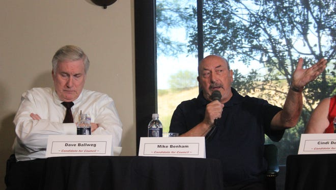 Mike Benham, right, talks Wednesday night during a candidate forum sponsored by Let's Talk Nevada and the Desert Valley Times.