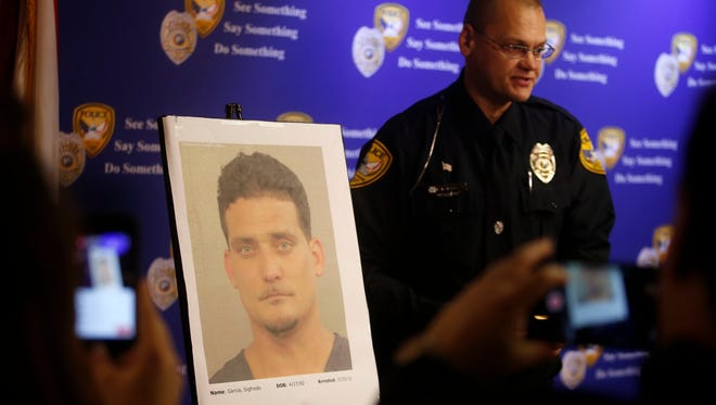 Tallahassee Police Department Public Information Officer David Northway reveals an image of Sigfredo Garcia, 34, during a press conference Thursday at the TPD station. Garcia was arrested in Broward County Wednesday, in connection with the July 2014 shooting death of Florida State University law professor Dan Markel.