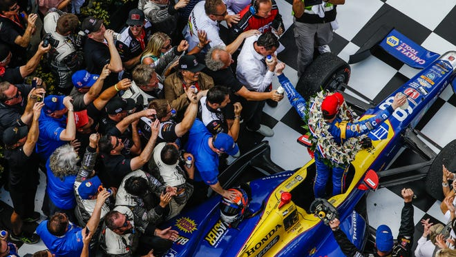 Alexander Rossi celebrates in victory circle