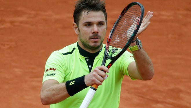 Stan Wawrinka celebrates winning the fourth round match of the French Open tennis tournament against Viktor Troicki Sunday at the Roland Garros stadium in Paris.