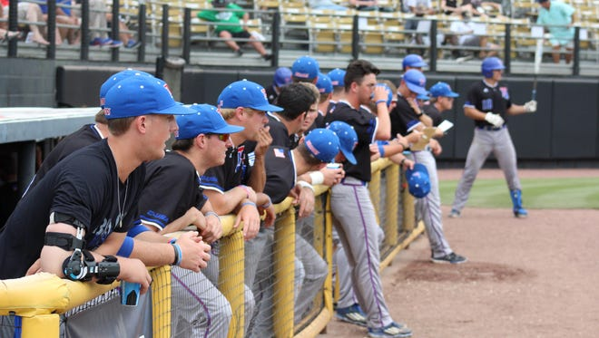 Louisiana Tech's dugout watches in during Saturday's game in the Conference USA Tournament.