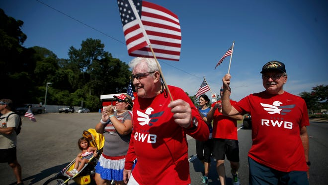 Ernie Andrus, a 92-year-old WWII veteran, reaches the finish line of his 6-mile run along Highway 90 on Memorial Day. Andrus is running coast to coast to raise money for the restoration of a D-Day landing ship, LST 325.