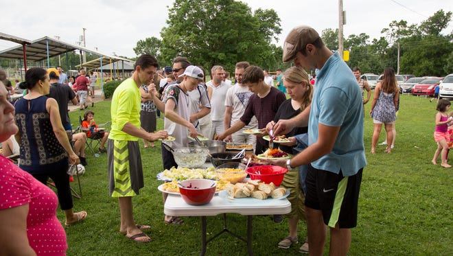 The families of Bread of Life Christian Church celebrated Memorial Day with a church picnic at Finley Park in Ozark. Family gatherings such as this, complete with traditional food, are held at least four times a year.