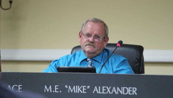 Ward 10 Councilman Mike Alexander asks Planning Commission director David Ripple about the Powell Road rezoning request at Thursday's City Council meeting.