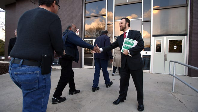 Congressional candidate for the 11th district, Joe Wenzel, shakes hands with voters before the start of the Morris County Democratic Committee nominating convention at Parsippany Hills High School to hear from major candidates and make endorsements for the upcoming election. April 7, 2016. Parsippany, N.J.