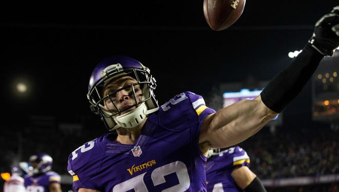 Dec 27, 2015; Minneapolis, MN, USA; Minnesota Vikings safety Harrison Smith (22) celebrates his interception for a touchdown during the second quarter against the New York Giants at TCF Bank Stadium.