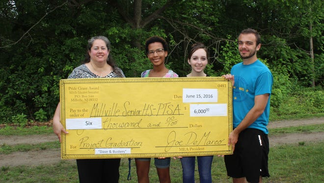 (From left) Tina Hulitt, president of the Millville Education Association, presents a check to Ariyanna Santiago, president of the Millville High School senior class; Chelsea Smith, president of the school's National Honor Society; and Raymond Slater, president of the student council, to help defray the cost of Project Graduation.