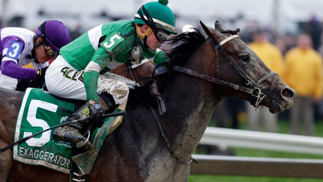 In this May 21, 2016, file photo, Exaggerator (5), with Kent Desormeaux up, moves past Nyquist, ridden by Mario Gutierrez, on the way to winning the 141st Preakness Stakes horse race at Pimlico Race Course in Baltimore.   Exaggerator has been made the 9-5 favorite in a field of 13 for Saturday's $1.5 million Belmont Stakes (AP Photo/Garry Jones, File)