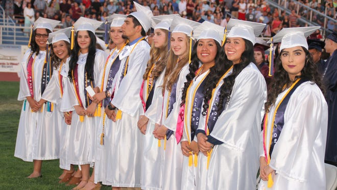 The Deming High School graduating class of 1026 was led by a Top 10 of Wildcat students. Eight graduating seniors were selected as valedictorian and two were honored as salutatorians. From left are: Yarely Ogaz, Arianna Reyes, Miquela Jurado, Amanda Borden, George Ortiz (salutatorian), Katelynn Goodman, Kelsey Smith, Brenda Herrera, Deanna Alvarez and Carmina Aragon (salutatorian). Valedicatorians carried a 4.0 grade point average and salutatorians carried a 3.92 GPA.
