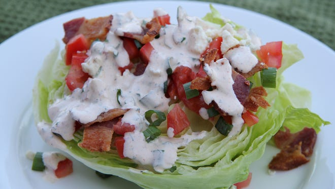 A chilled iceberg wedge with garnishes and homemade buttermilk ranch dressing is a perfect salad on a hot summer day.