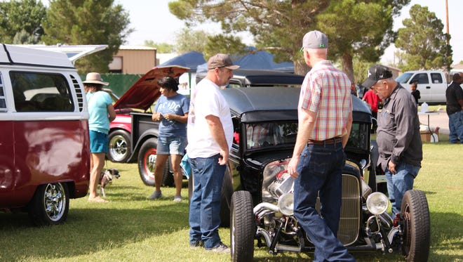 Summer came a bit early on Saturday at Rabbit Park on Deming's north side. The full day of activities celebrated children let out of school and the various city and county organizations that serve Deming and Luna County. Car enthusiasts shared tricks and trades while taking a look at some of the cars presented by the Desert Classics Car Club.  Daniel Mendoza, 12, spins a hula hoop around his neck in a contest hosted by Luna County's Parents As Teachers.  Josiah Hernandez, 3, will soon be transformed into a Teenage Mutant Ninja Turtle when his face painting episode is done. The park drew over 1,000 visitors for the day-long event.