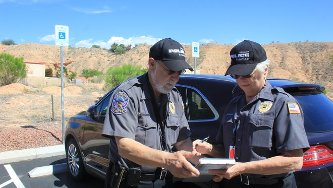 Russ and Jean Batthelia volunteer for the Mesquite Police Department writing handicap parking tickets, checking vacation homes and helping out with accidents and special events.