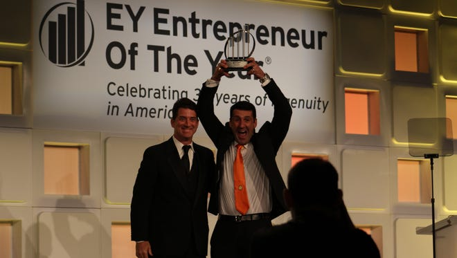 Scrub Daddy inventor Aaron Krause poses with EY Entrepreneur of the Year award