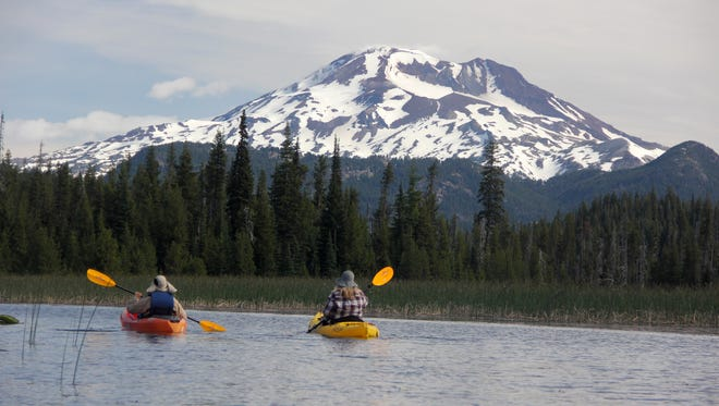 Two kayakers paddle Hosmer Lake, west of Bend, which has stunning views of South Sister.