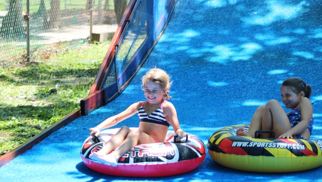 Summer campers at the JCC Camps at Medford enjoy tubing down a giant slide. Hungry campers need healthy lunches.