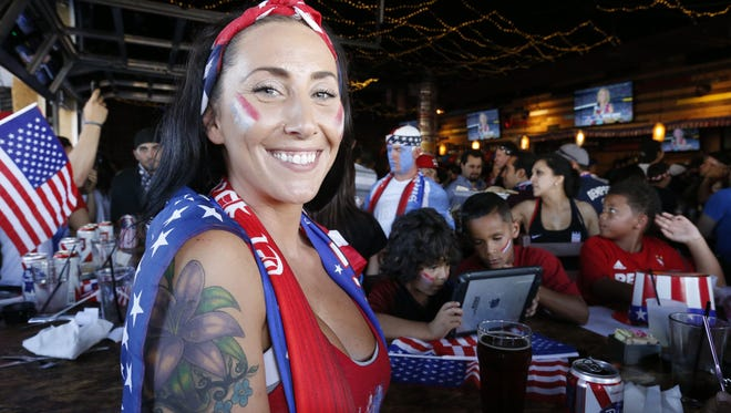 Mandi Douglass cheers for the U.S. soccer team Tuesday at the Brass Monkey as the team plays against Argentina in the Copa America semifinals.