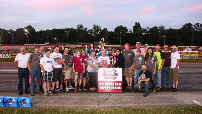 Booper Bare, Tommy Bare, Buzzy Walters and other family and friends pose for a photo after Tommy Bare's win.
