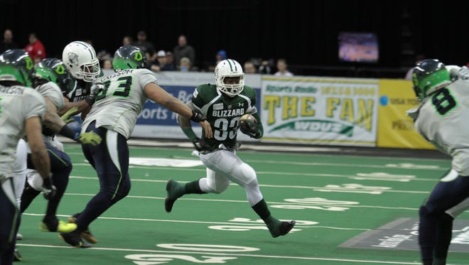 Green Bay Blizzard running back Keshaudas Spence heads up field during an Indoor Football League game against the Nebraska Danger at the Resch Center this year. Spence received a tryout with the Green Bay Packers last week.