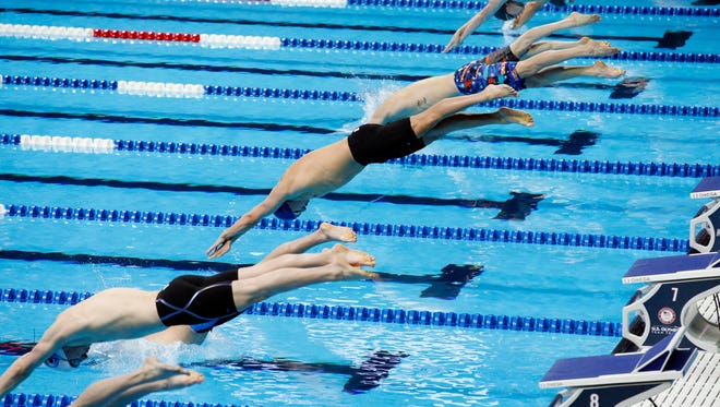 A general view as competitors in heat 4 dive into the pool for the start of the men's 400 freestyle June 26.