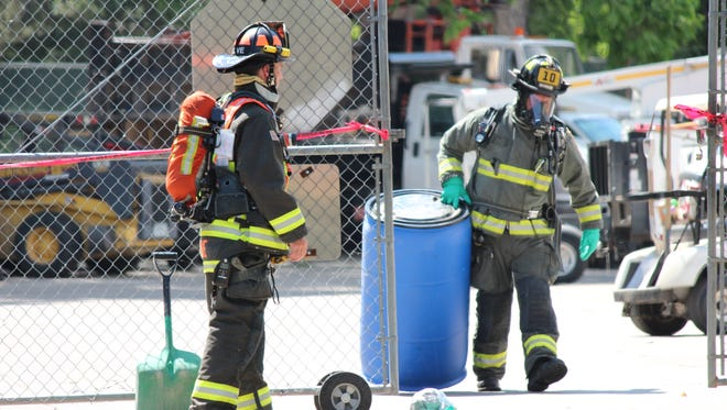 Firefighters respond to a call about a man burned by an unknown chemical in a garbage bag near City Park on June 27.