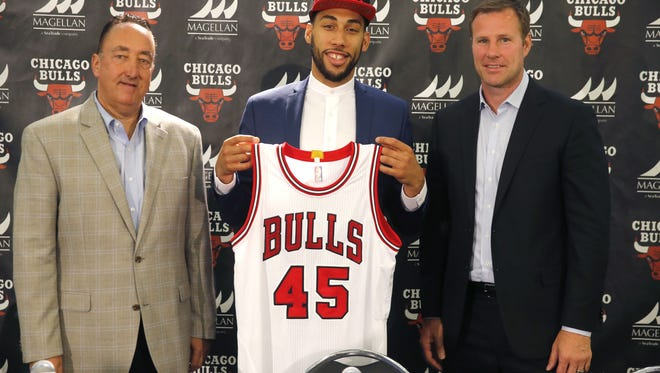 Chicago Bulls general manager Gar Forman, left, and head coach Fred Hoiberg, right, pose next to first-round draft pick Denzel Valentine after Valentine was introduced in a press conference Monday in Chicago. The Bulls selected the former MSU and Lansing Sexton star with the 14th overall pick in last Thursday's NBA Draft.
