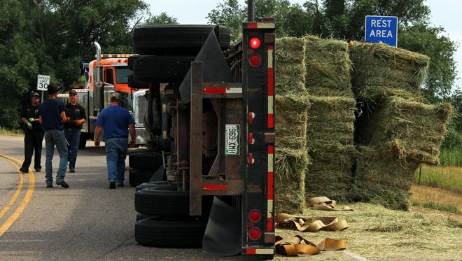 A semi carrying hay to a Fort Collins farm rolled Wednesday afternoon. Its driver told police he felt the load shift as he took a turn, and the truck tipped.