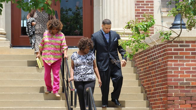 Derrick Stafford (right) leaves the Avoyelles Parish Courthouse on Wednesday with members of his family after a hearing in his case. Stafford faces charges of second-degree murder and attempted second-degree murder.