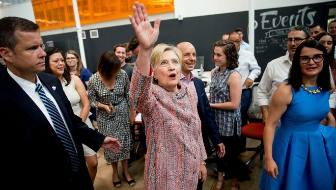 Democratic presidential candidate Hillary Clinton waves to workers while visiting Galvanize, a work space for technology companies, in Denver. While there, Clinton said the House Benghazi committee found nothing different than previous investigations in their latest look into the deaths there.