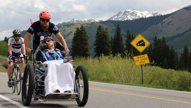 "Zach Yendra of Fort Collins redesigned his popular ""Bootlegger"" cargo bike so he could transport former cyclist Mike Cimbura, who now has ALS, on the three-day Death Ride Tour."