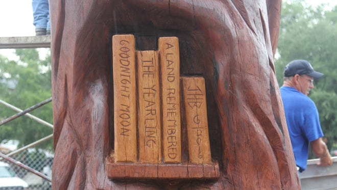 Tree carver John Birch incorporated books into his carving at the LeRoy Collins main branch library downtown.