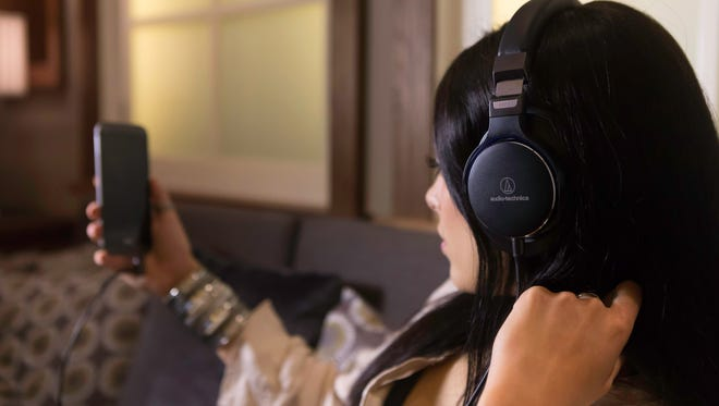 The Audio Technica ATH MSR7NC noise-cancelling headphones.