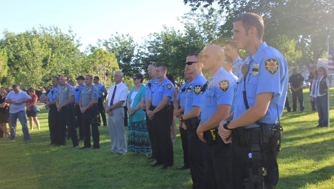 St. George law enforcement officers listen to a memorial service in honor of them after the tragic Dallas police shootings.