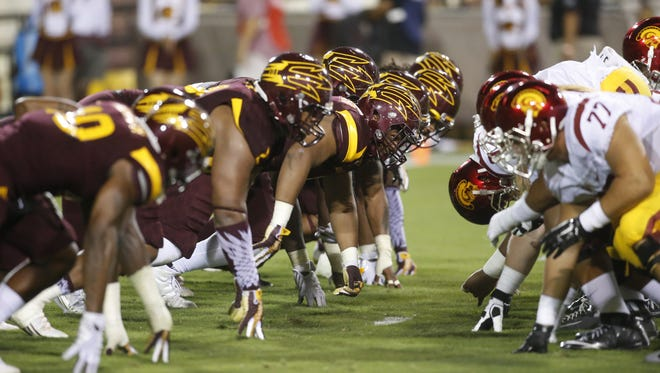Arizona State University defense lines up against  University Southern California offense during a college football at Sun Devil Stadium in Tempe on Saturday, September 26, 2015.
