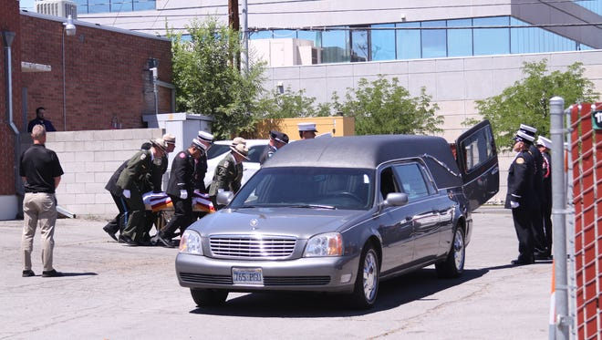 The Bureau of Land Management, National Park Service and Carson City Fire Department honor guards move Jacob M. O'Malley's body during the procession on July 13.