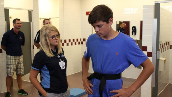 Jessica Langston (left), certified athletic trainer conducts a balance test for Jacob Ferris  (PHS XC, soccer, tennis) at Wednesday's baseline concussion testing.