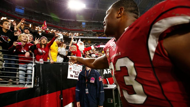 Fans cheer for Calais Campbell after the Arizona Cardinals defeated the Green Bay Packers on Dec. 27, 2015 in Glendale, Ariz.