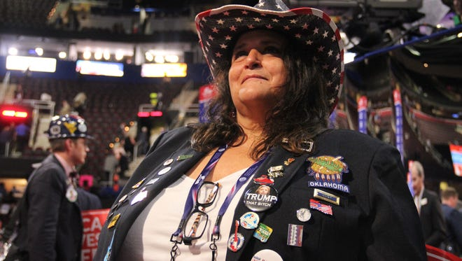 Oklahoma delegate Monica Deon wears more than two dozen pins to show her support for Donald Trump.